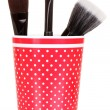 Cosmetic brushes in cup isolated on white - Stock Photo