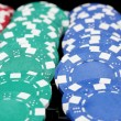 Stock Photo: Casino chips close-up isolated on black