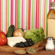 Royalty-Free Stock Photo: Ingredients for a Greek salad on bright striped background close-up