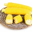 Fresh corn on wicker mat isolated on white — Stock Photo
