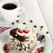 Royalty-Free Stock Photo: Sweet cake with chocolate on plate and cup of coffee on wooden table