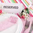 Table setting with reserved card in restaurant - Stock Photo