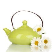 Teapot with chamomile tea isolated on white — Stock Photo