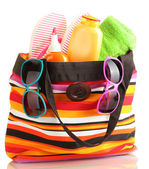 Beach bag with beach accessories, isolated on white — Zdjęcie stockowe