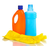 Detergent and gloves isolated on white — Stock Photo