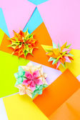 Colorfull origami kusudamas on bright paper background — Stockfoto