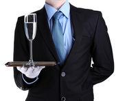 Garçom formal com um copo de água na bandeja de prata isolada no branco — Foto Stock