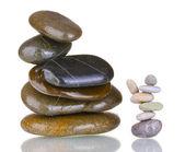 Stacks of balanced stones isolated on white — Stock Photo
