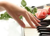 Hand of woman playing piano — Stock Photo