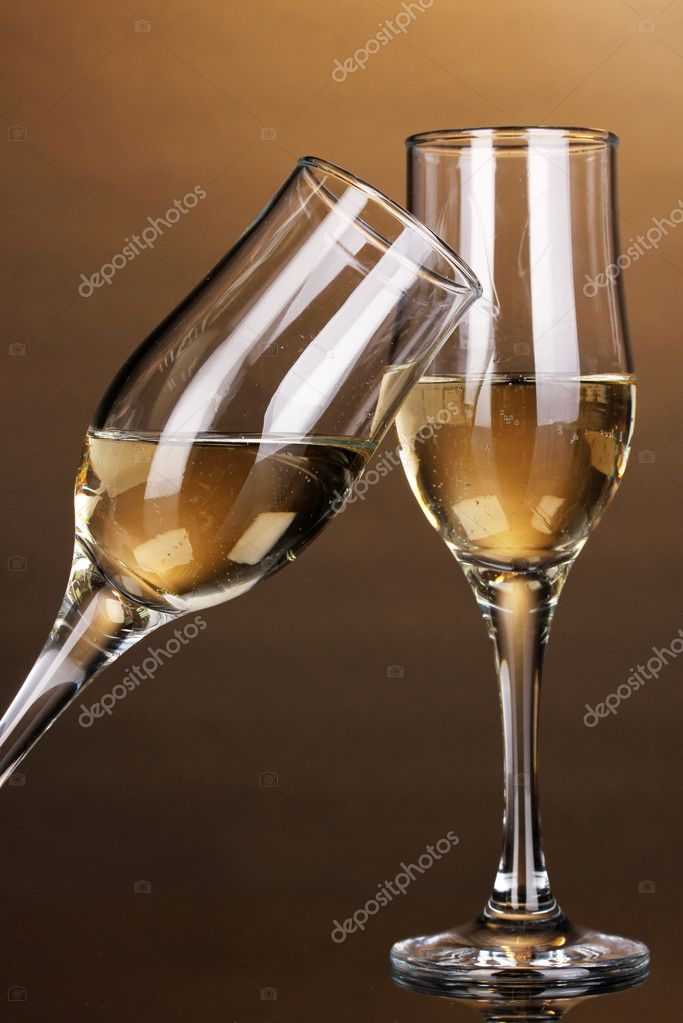 Glasses of champagne on brown background  Stock Photo #11604319