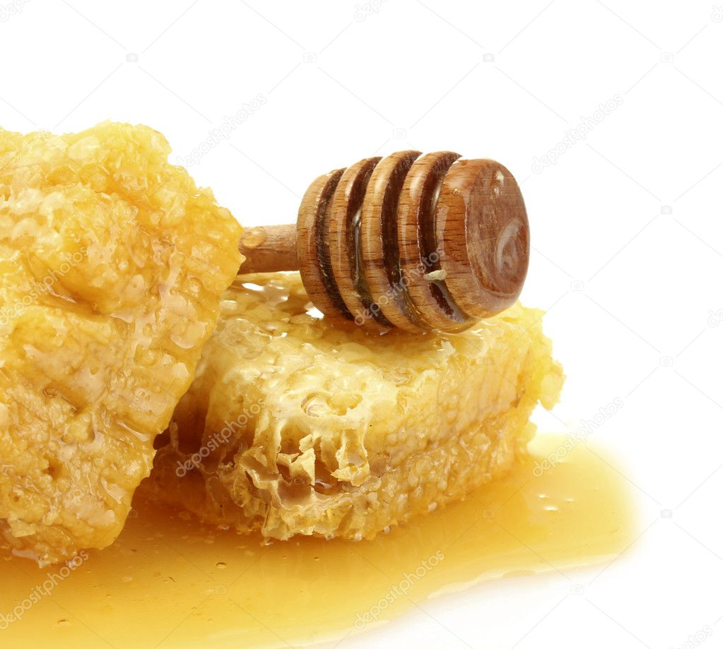 Golden honeycombs and wooden drizzler with honey isolated on white — Stock Photo #11604677
