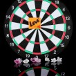 Stock Photo: Darts with sticker symbolizing love isolated on black background