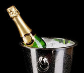 Bottle of champagne in bucket isolated on black — Stock Photo