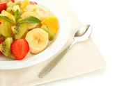Fresh fruits salad on plate isolated on white — Stock Photo