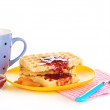 Tasty waffles with jam on plate isolated on white — Stock Photo