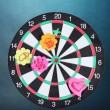 Stock Photo: Darts with stickers depicting life values on colorful background. darts hit target