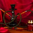 Hookah on a wooden table on a background of red curtain close-up - Foto de Stock
