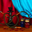 Hookah on a wooden table on a background of curtain close-up - Стоковая фотография
