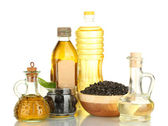 Olive and sunflower oil in the bottles and small decanters isolated on white — Stock Photo