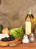 Ingredients for a Greek salad on canvas background close-up — Stock Photo