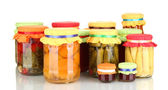 Jars with canned fruits and vegetables isolated on white — Stock Photo