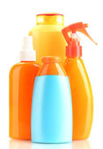 Bottles with suntan cream isolated on white — Stockfoto