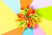 Colorfull origami on bright paper background — Stock Photo