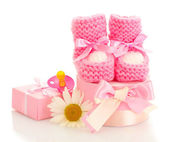 Pink baby boots, pacifier, gifts and flower isolated on white — Stok fotoğraf