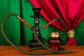 Hookah on a wooden table on a background of curtain close-up — Foto de Stock