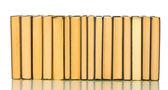 白い背景で隔離の本の山 — ストック写真