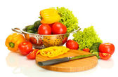 Fresh vegetables and knife on cutting board isolated on white — Stock Photo