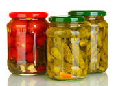 Jars of canned vegetables isolated on white — Stock Photo
