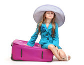 Portrait of little girl with travel case and hat isolated on white — Stok fotoğraf