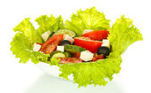 Tasty greek salad isolated on white — Stock fotografie