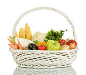 Fresh vegetables in white basket isolated on white — Stock Photo
