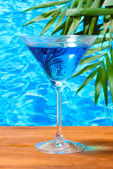 Glass of cocktail on blue sea background — Stok fotoğraf