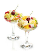 Fresh fruits salad isolated on white — Stock Photo