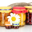 Jar with canned fruit on canvas background close-up — Stock Photo