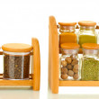 Jars with spices on wooden shelfs isolated on white — Stock Photo