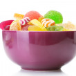 Colorful jelly candies in purple bowl isolated on white — Stock Photo #11676239