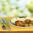 Roasted chicken leg with mashed potato in the plate on wooden table on bright background close-up — Stock Photo