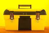 Yellow tool box on yellow background close-up — Stock Photo