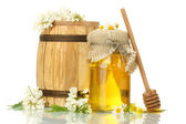 Sweet honey in barrel and jar with acacia flowers isolated on white — Stock Photo
