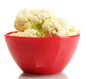 Fresh cauliflower in bright bowl isolated on white — Stock Photo