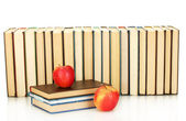 Pile of books with apples on white background close-up — Stock Photo