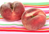 Ripe fig peaches on napkin isolated on white — Stock Photo