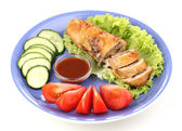 Tasty meat cutlet with garnish on plate isolated on white — Stock Photo