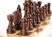 Chess board with chess pieces isolated on white — Stock Photo