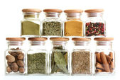 Powder spices in glass jars isolated on white — Stock Photo