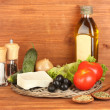 Stock Photo: Ingredients for Greek salad on wooden background close-up